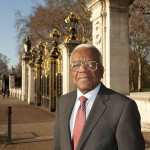 Trevor McDonald in front of Canada Gate at Buckingham Palace, London