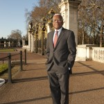 Trevor McDonald in front of Canada Gate at Buckingham Palace, London.