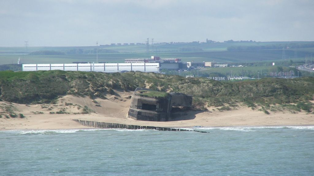 World War II-era bunkers line the shore of Calais in northern France. Photo by Piotr_Kuczynski/
