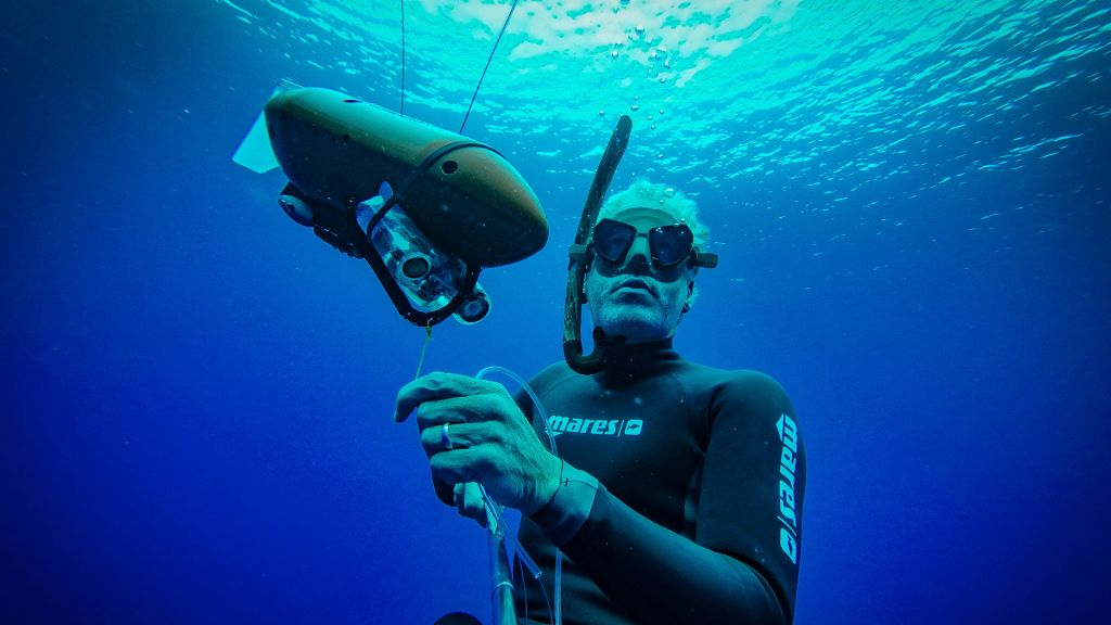 "Gordon Buchanan waits to deploy a ""Tow-cam"" on a devil ray"
