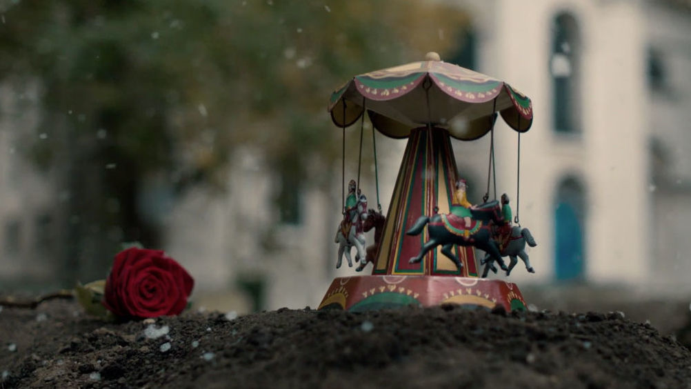 Reggie's toy carousel gift at the grave of Barbara in Call the Midwife Season 7, Episode 8 finale.