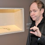 Teller checks out the exhibit