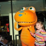 Buddy from Dinosaur Train greets a young fan
