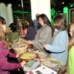 Visitors check out the Kids Club Thirteen table