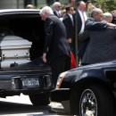 A group of men hug as caskets are loaded into hearses at Our Lady of Victory Roman Catholic Church in Flora Park, NY, Thursday, July 30, 2009.  The funeral mass was for Diane Schuler, Erin Schuler, Kate Hance, Alyson Hance and Emma Hance, all of whom died in a minivan going in the wrong direction on a parkway and crashed on Sunday, killing eight people total.  AP Photo/Seth Wenig