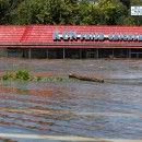 A restaurant in Paterson, N.J. flooded by the overflowing Passaic River on Aug. 30. On Wednesday, federal officials will survey the damage in New Jersey. AP/Julio Cortez.