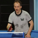 "Will Shortz has an unusual grip, which you can see in this photo. The grip is called the ""seemiler grip"" and is named after a table tennis champion. Photo by Don Christensen."