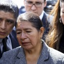 Rosario Lucero, center, stands near the site where her son Marcelo Lucero was stabbed to death in 2008, in Patchogue, N.Y., Monday, April 19, 2010, after his killer, Jeffrey Conroy, was convicted of manslaughter as a hate crime but acquitted of murder. At left is Lucero's brother Joselo Lucero, and at right is sister Isabel Lucero. The family went to the site of the incident after they left the Suffolk County courthouse Monday. AP Photo/Craig Ruttle