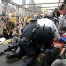 In this Oct. 1, 2011 photo, police make their way a crowd of protesters who were the front line on New York's Brooklyn Bridge when police began making arrests during Saturday's march by Occupy Wall Street. Protesters speaking out against corporate greed and other grievances attempted to walk over the bridge from Manhattan, resulting in the arrest of more than 700 during a tense confrontation with police. The majority of those arrested were given citations for disorderly conduct and were released, police said. AP Photo/Stephanie Keith