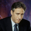 Jon_Stewart_At_Desk_II_130x130