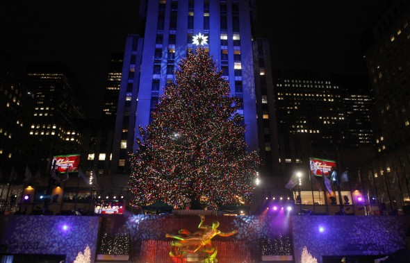 The Rockefeller Center Christmas tree stands lit during the 78th annual lighting ceremony Nov. 30, 2010, in New York. Not up for the crowds this year? There are plenty of other tree lighting events in the Tri-State area. AP Photo/Jason DeCrow