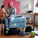 Natasha Glasgow and her son, Alfredo, in their foreclosed building in Far Rockaway, Queens. On Dec. 6, Occupy Our Homes illegally entered and cleaned a vacant foreclosure in East New York, where Natasha plans to move her family later this week. Photo courtesy of Sam Lewis.