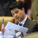 Assemblyman George Amedore, of the 105 Assembly district reads a Bills Calendar before voting during a New York state Assembly session at the Capitol in Albany, N.Y., Tuesday, June 14, 2011. (AP Photo/Hans Pennink)