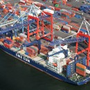 A container ship owned by CMA CGM unloads cargo at the Port of Newark, N.J. A new project to replace two water tunnels in the Anchorage Channel is part of a plan to prepare for massive post-Panamax ships that will soon pass through the Panama Canal and make their way up the Eastern seaboard.