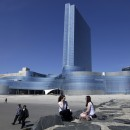 Two women sit on a jetty near Revel in Atlantic City, N.J.. The casino-resort opened April 2, and New Jersey officials hope it will help Atlantic City compete with gambling industries in neighboring states. AP/Mel Evans