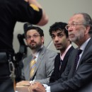 Dharun Ravi, center, listens to a court officer with his attorneys Philip Nettl, left, and Steve Altman, during his sentencing in New Brunswick, N.J., Monday, May 21, 2012. Ravi, a former Rutgers University student who used a webcam to watch his roommate kiss another man days before the roommate killed himself was sentenced Monday to 30 days in jail. A judge also gave 20-year-old Dharun Ravi three years of probation. AP/Mel Evans