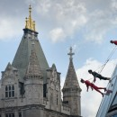 "Elizabeth Streb and two company members perform ""Skywalk"" on the City Hall of London on July 15, 2012."