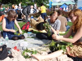 Revelers create flower wreaths at the Swedish Midsummer Festival. Photo by Karin Ander.