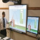 Brooklyn Tech teacher uses modern Smart Board technology. Photo courtesy of the Brooklyn Tech Alumni Foundation.