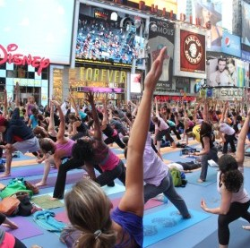 New Yorkers strike a side angle pose during a yoga class in Times Square. Photo courtesy of Times Square Alliance.