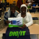 Murray Hill Academy student Niles Flowers and his mother Jerine Wentt display Niles' new laptop he received after completing the
