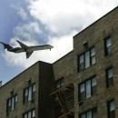 An airplane passes over an apartment building on its way to LaGuardia Airport. The FAA and Port Authority have soundproofed many of the schools around the city's airports, researcher Charlotte Clark said nobody is really sure how effective these measures are. AP/Frank Franklin