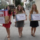 Three teens from Montclair, NJ, attempted to deliver boxes of petitions to the Commission on Presidential Debates, requesting a female moderator in this year's presidential debates. Pictured (left to right) are Sammi Siegel, Emma Axelrod and Elena Tsemberis.  Photo courtesy of Change.org
