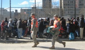 National Guard members brought food and water to the distribution site at Surf Avenue.