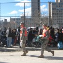 The National Guard delivered cases of food and water to a distribution site at Surf Avenue and W. 25th Street in Coney Island, Brooklyn.
