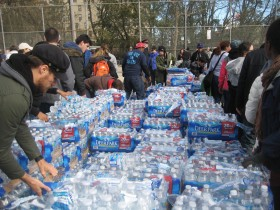 Volunteers at the Coney Island food and water distribution site, one of 14 official sites in New York City, delivered water bottles to every floor of NYCHA housing complexes in the area, most of which were without hot water, heat and electricity.