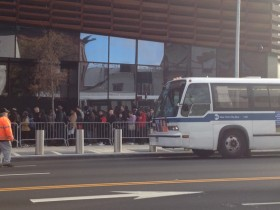 "After looping around the Barclays Arena in a line, passengers boarded the free ""bus bridge"" service at Atlantic Avenue."