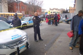 One of four to five police officers who monitored the line at a Hess Station in Flatbush, Brooklyn on Nov 1, 2012. Gas supply was short and drivers had to stand in line to get their fuel, rather than drive up.