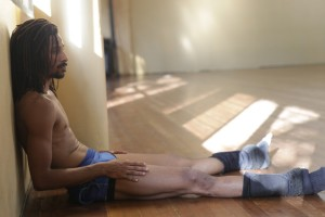 Osnel Delgado taking a break between rehearsals. The dancers practice for 6 - 8 hours everyday, and there's very little resting.