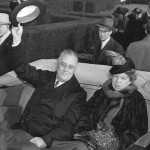 Franklin and Eleanor Roosevelt riding in an open car, returning to the White House from FDR's third inauguration in 1941. Photo Credit: Library of Congress.